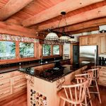 Rustic and Regal Log Cabin Kitchen